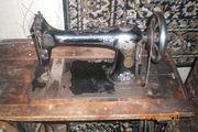 швейную машинку зингер  834700